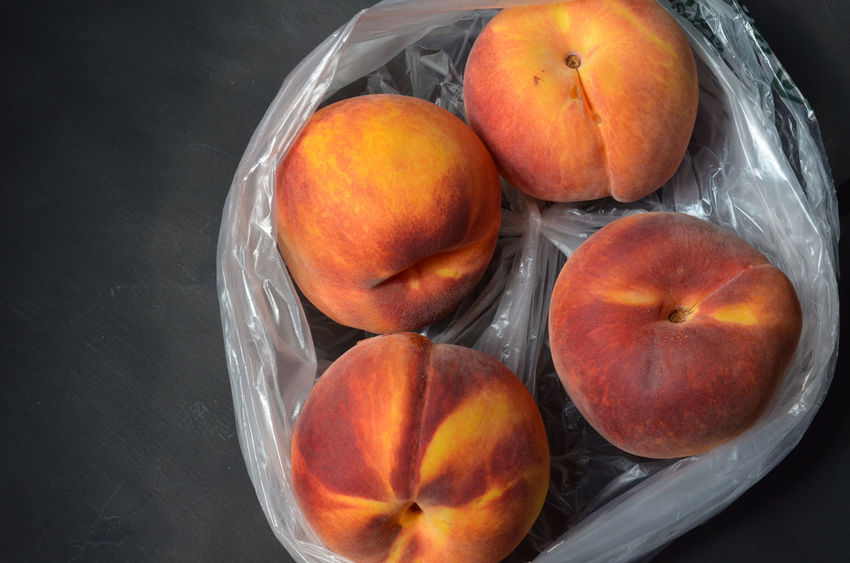 overhead view of peaches in plastic grocery store bag Food Fresh Produce Freshness Fruit Fruit Bowl Healthy Eating Indoors  Indulgence No People Orange Color Peach Peaches Raw Food Ready-to-eat Ripe Ripe Fruit