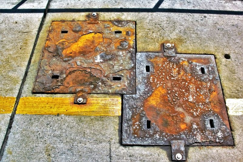 Cutting Corners (Creativity Has No Limits) Close-up Concrete Covers Creativity Has No Limits Cutting Corners Day Harbor Lines And Shapes Man Made Object Metal No People Old Quay Quayside Rusty Urban Geometry Weathered Well  Yellow Break The Mold