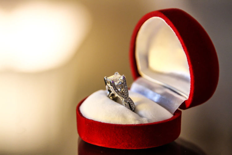 Close-up Day Diamond Ring Engagement Ring Finger Ring Indoors  Jewelry Life Events No People Red Ring