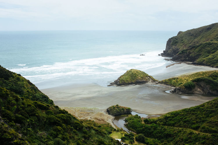 Anawhata Beach, near Auckland, New Zealand Alone Breathtaking Desolate Grass Green Nature Scenic Tranquility Anawhata Beach Beauty In Nature Black Sand Beach Cliff Hill Horizon Horizon Over Water Lush New Zealand Ocean Outdoors Rocks Rocks And Water Sea Water Waves