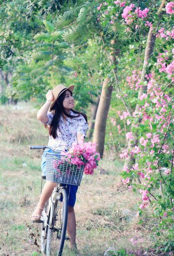Young woman riding bicycle at park