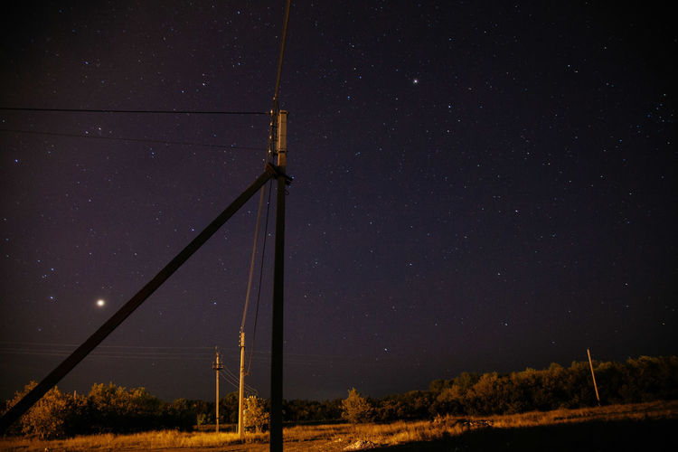 Sky and Stars Nightphotography Astronomy Beauty In Nature Cable Connection Electricity  Fuel And Power Generation Galaxy Industrial Windmill Long Exposure Nature Night No People Outdoors Sky Skyporn Star - Space Technology Wind Power Wind Turbine Windmill