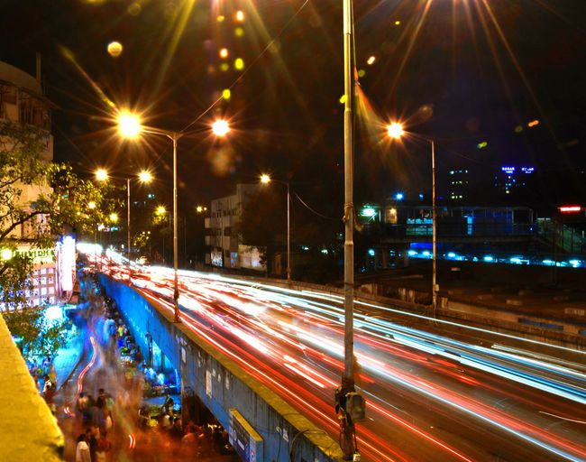 Its insane how cities in mumbai funcion , millions of people cramped up in a narrow lane for just for Nightshopping Illuminated Long Exposure Light Trail Street Light Traffic Motion City Speed Transportation Tree City Life Architecture Built Structure No People Outdoors Cityscape Sky