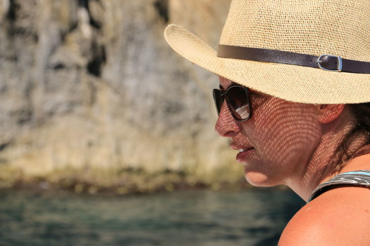 Day Focus On Foreground Hat Headshot Leisure Activity Lifestyles Nature One Person Outdoors People Real People Sunglasses Water Young Adult