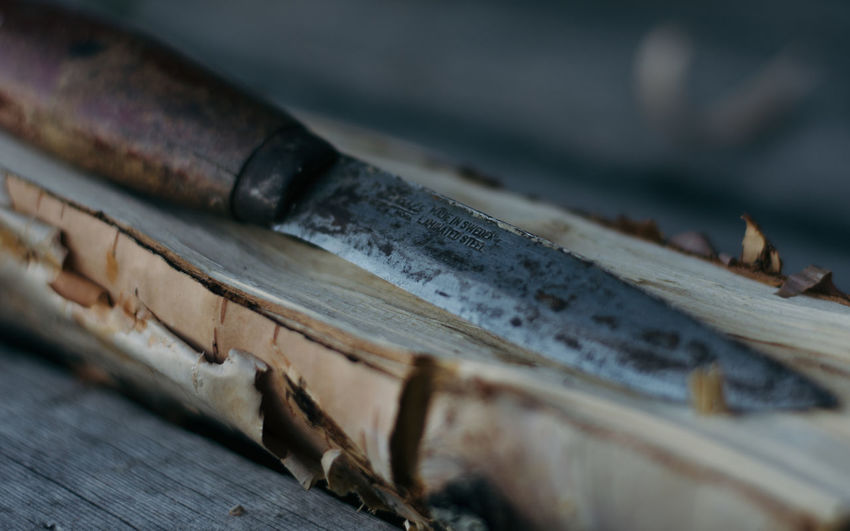 Close-up of knife on wood