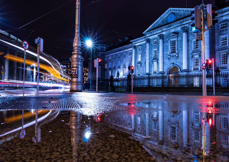 Trinity College, Dublin EyeEm Best Shots EyeEmNew Night Traffic Reflections Traffic Lights Calm EyeEm Best Shots EyeEm Gallery Trinity College Dublin Trinity College Dublin Streetphotography Street A7RII Sonyalpha Ireland College College Life City Water Illuminated Cityscape Nightlife Reflection Arts Culture And Entertainment Sky Architecture