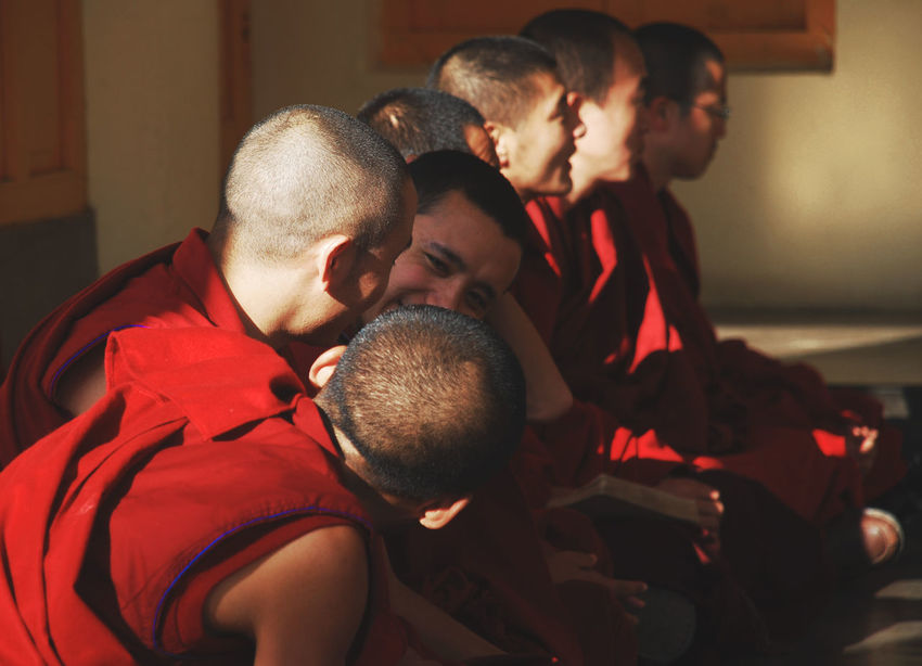 Buddhist monks sitting in line, Dharamshala, Inda Adult Buddha Buddhism Dalai Lama Dharamshala India Indoors  Lines Men Monks People Real People Red Color Red Robin Religion Sitting Smiling Spirituality Talking Temple