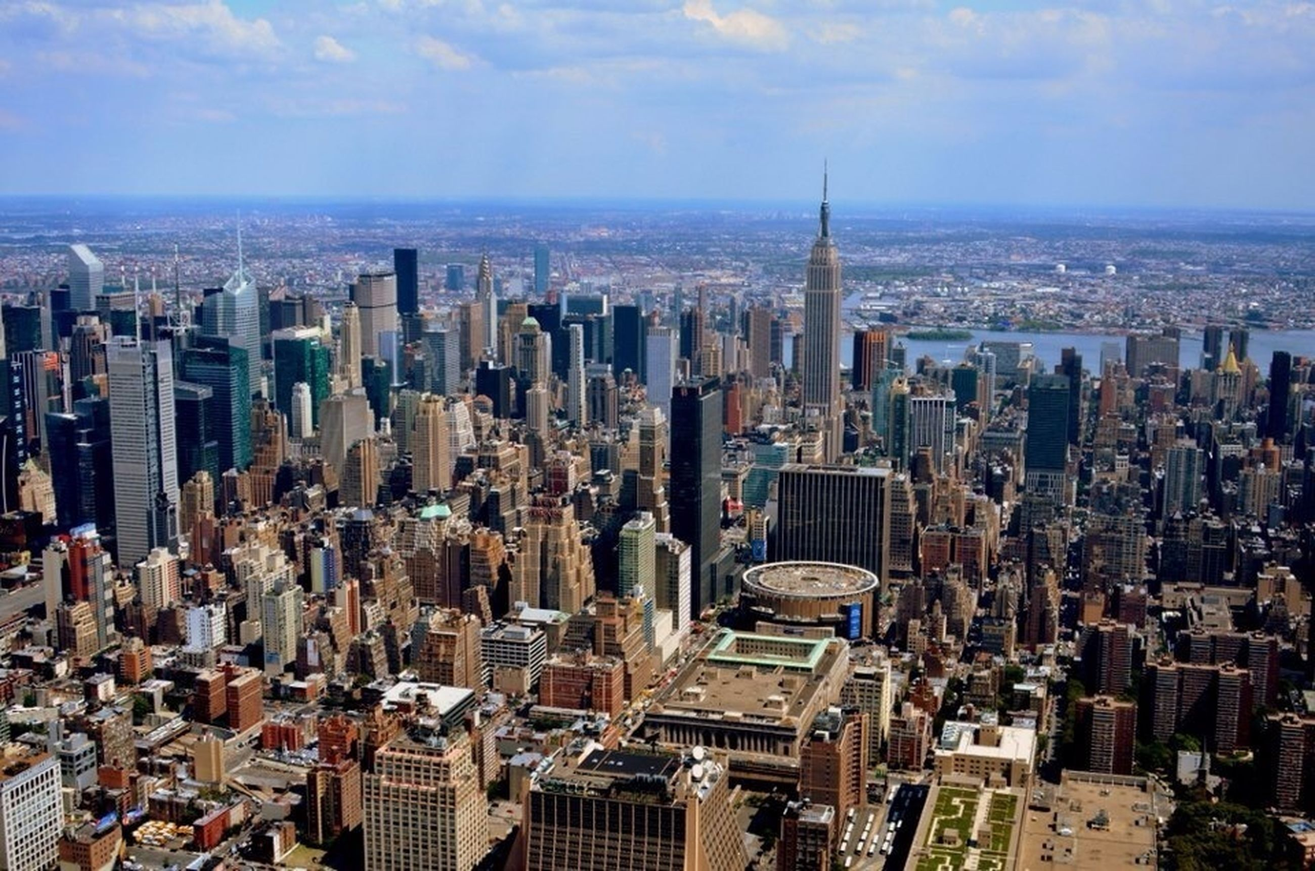 city, cityscape, building exterior, architecture, skyscraper, built structure, crowded, tall - high, tower, modern, office building, sky, financial district, high angle view, capital cities, urban skyline, travel destinations, city life, downtown district, cloud - sky