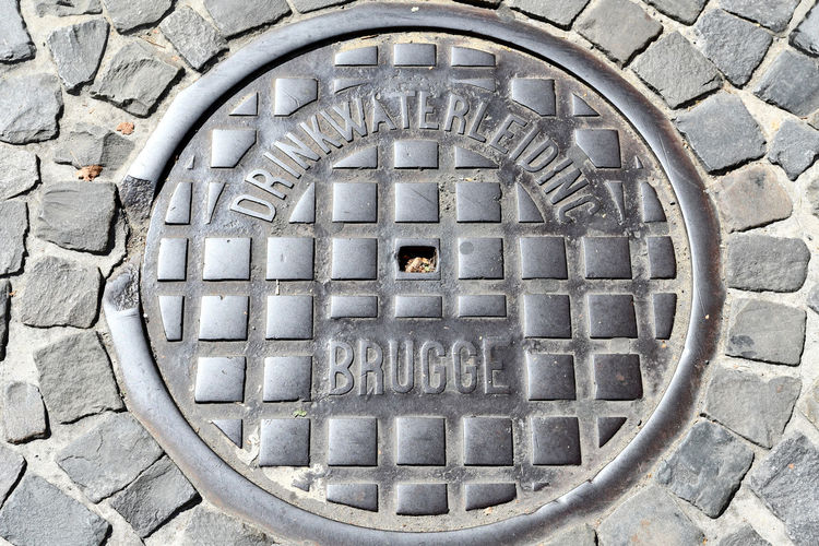 Brugge Brugge, Belgium Drain Cover Backgrounds Circle Close-up Directly Above Geometric Shape Metal Streetphotography