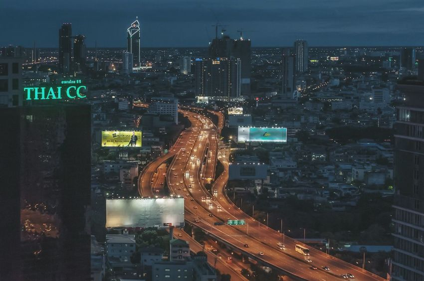 Bangkok Thailand Illuminated City Architecture Building Exterior Road Built Structure Cityscape Street Night High Angle View City Life Light Trail Tower Sky Development City Street Tall - High Cloud Office Building Skyscraper Nightphotography ASIA Bangkok Thailand.