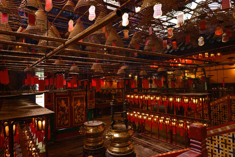 Man Mo temple ASIA Asian Culture Faith Hong Kong Hong Kong City Lantern Man Mo Temple Red Taoism TaoistTemple Architecture China Chinese Coil Illuminated In A Row Incense Indoors  Large Group Of Objects Manmotemple No People Religion Religious  Religious Architecture Wood - Material