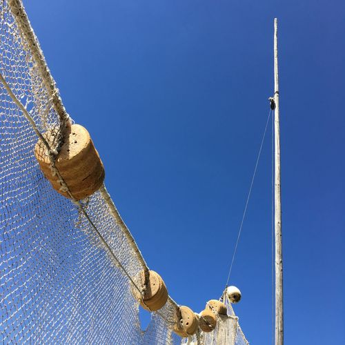 EyeEm Selects Fish net.... Hanging Blue Low Angle View Clear Sky No People Day Outdoors Close-up Sky Fish Net