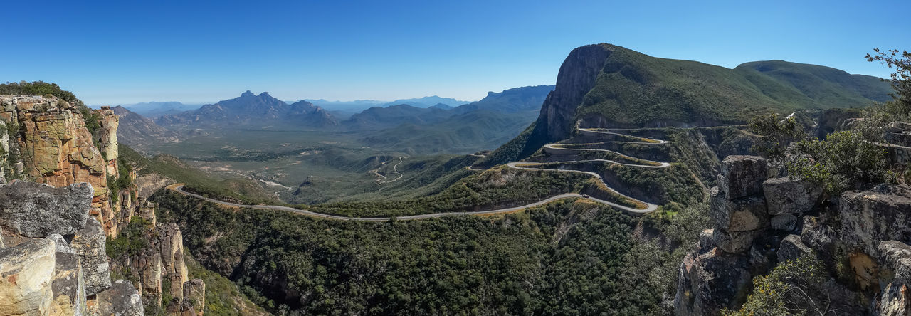 The impressive Serra da Leba pass in Angola. The road gains altitude quickly over several serpentines. Angola Panorama Road Beauty In Nature Clear Sky Day Landscape Mountain Mountain Pass Mountain Range Mountain Road Mountains Nature No People Outdoors Physical Geography Road Rock - Object Scenics Sera Da Leba Sky The Way Forward Tranquil Scene Travel Destinations Winding Road
