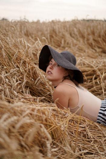 Side view of girl wearing hat on field
