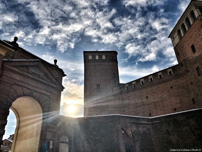 a history of towers and arches Italy Piedmont Fossano Defence Winter Tourism Travel Clouds Sun Castle Towers Architecture Low Angle View Built Structure Sky Cloud - Sky Building Exterior Sunlight History Travel Destinations Day Outdoors No People Triumphal Arch