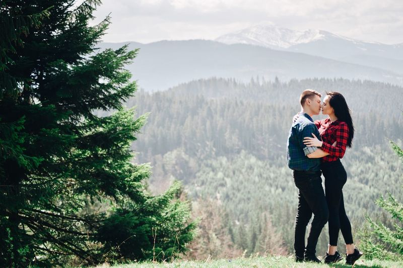 Stylish young hipster couple in love in the mountains. Togetherness Two People Plant Men Tree Love Bonding Women Positive Emotion Mountain Leisure Activity Emotion Females Adult Real People Family Males  Full Length Child Scenics - Nature Outdoors Son