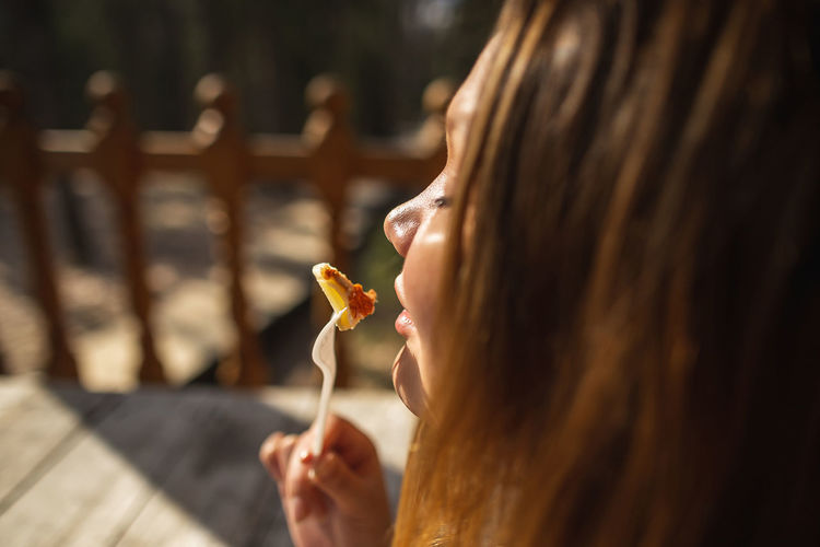 Close-up of woman eating food