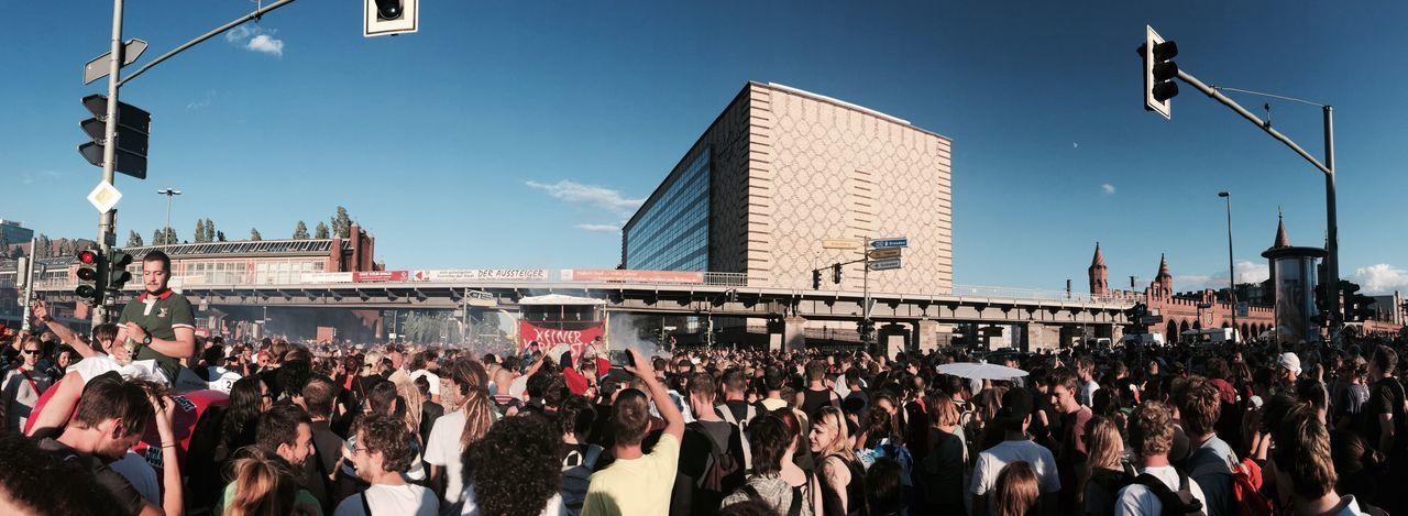 Crowd On City Streets Against Oberbaum Bridge