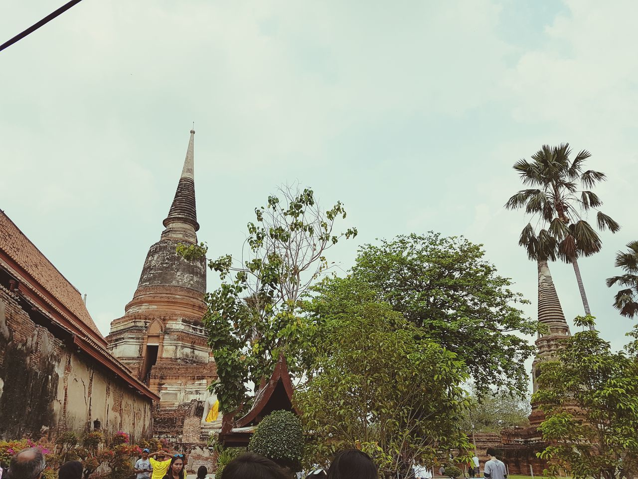 religion, place of worship, architecture, spirituality, built structure, tree, building exterior, history, sky, day, travel destinations, ancient, real people, men, outdoors, ancient civilization, nature, people