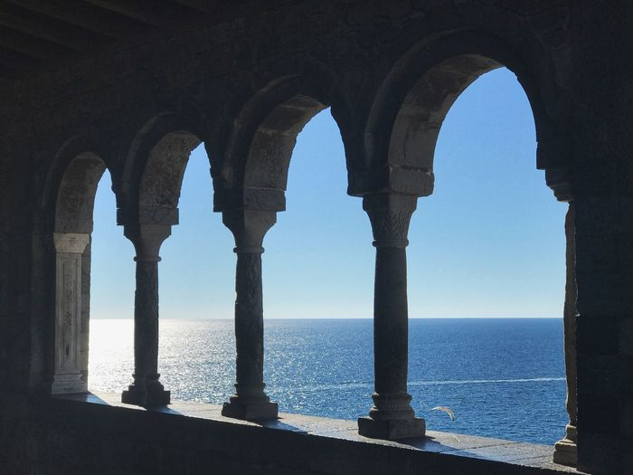 Arches with a view. Enjoying The Sun Cinque Terre Italy Arches Water Sea Arch Sky Architectural Column Architecture Nature Clear Sky Horizon Horizon Over Water Day Built Structure No People Sunlight Outdoors Tranquil Scene Scenics - Nature Tranquility
