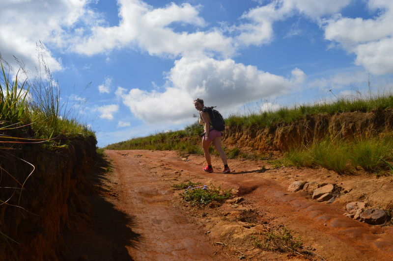 Charlotte hiking in South Africa Adventure Backpack Backpacker Backpacking Dirtroad Female Backpacker Girl Hiking Hiking Hikingadventures Outdoors South Africa The Way Forward Travel Travel Photography Traveling Woman Backpacker Woman Hiking Let's Go. Together.