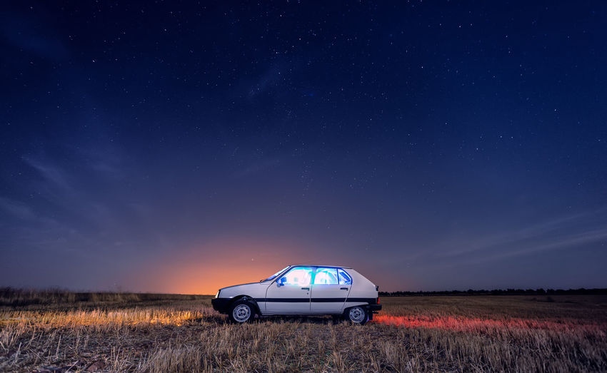 View of car on field at night