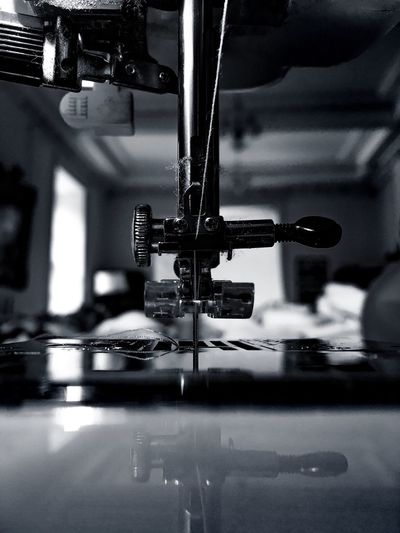 Extreme close-up of sewing machine