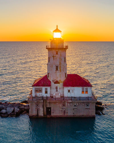 Chicago Henge thru the lighthouse Chicago Chicago Skyline Drone  Lighthouse Aerial View Architecture Beauty In Nature Chicagohenge Clear Sky Horizon Over Water Lighthouse_captures No People Sea Sky Sunrise Sunset Water