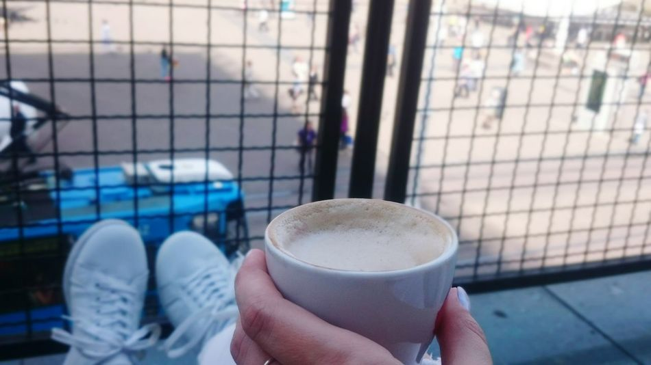 EyeEm Selects Coffee - Drink Coffee Cup Holding Personal Perspective Latte Close-up Cappuccino One Person Human Hand Human Body Part Focus On Foreground Lifestyles Streetphotography Real People People City View  City Street City Life City View  City