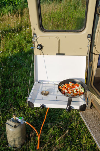 High Angle View Of Vegetables On Camping Cooker