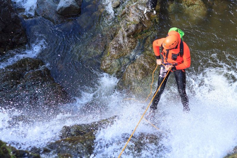 Cumbrian Canyoning Lake District National Park Canyoning Abseilling Wetsuit Needed Waterfalls Water One Person Nature Motion Day Real People Sport Leisure Activity Helmet Adventure Outdoors Lifestyles Sunlight