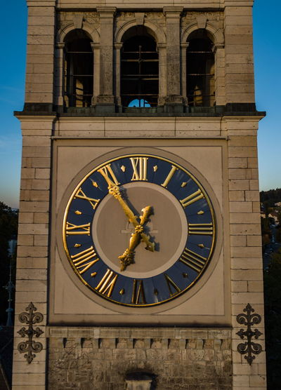 Architecture Building Exterior Built Structure City Clock Clock Face Clock Tower Day History Minute Hand No People Outdoors Roman Numeral Sky Statue Time Travel Destinations Window