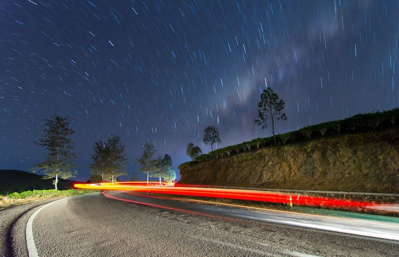 Star trail at tea plantation Star Trail Landscape Landscape_Collection Indonesia Photography  Landscape_photography INDONESIA Nightshot Bestskyshot Mybest_shot Astronomy Galaxy Space Star - Space Milky Way Mountain Road Star Trail Red Astrology Sign Light Trail Long Exposure Star Field Infinity Star