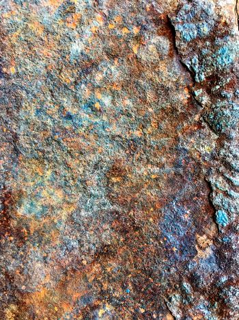 Full frame shot of Rusty texture on metal surface Full Frame Backgrounds Pattern No People Day Close-up Textured  Outdoors Abstract Rough Textile Creativity High Angle View Nature Art And Craft Multi Colored Beach Solid Rock