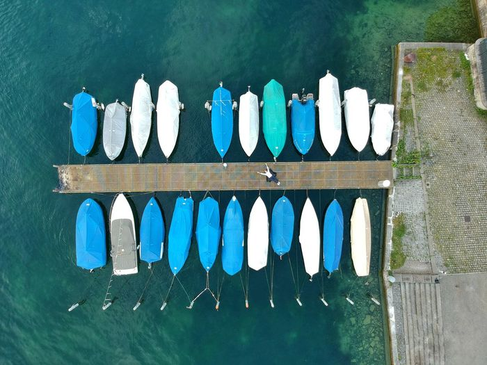 Chilling at Limmatquai - Zürich, Switzerland 2018 Pier Limmatquai Quai Birdseyeview Dronephotography Dji Spark DJI X Eyeem No People Day Side By Side Blue Directly Above Nature Arrangement Communication In A Row Close-up Wood - Material Water White Color Outdoors Variation High Angle View Architecture Text Green Color #FREIHEITBERLIN The Traveler - 2018 EyeEm Awards Summer In The City