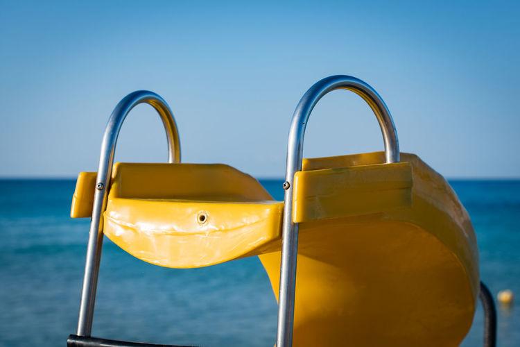 Yellow skid row at the beach Skid Row Beach Yellow Contrast Horizon Over Water