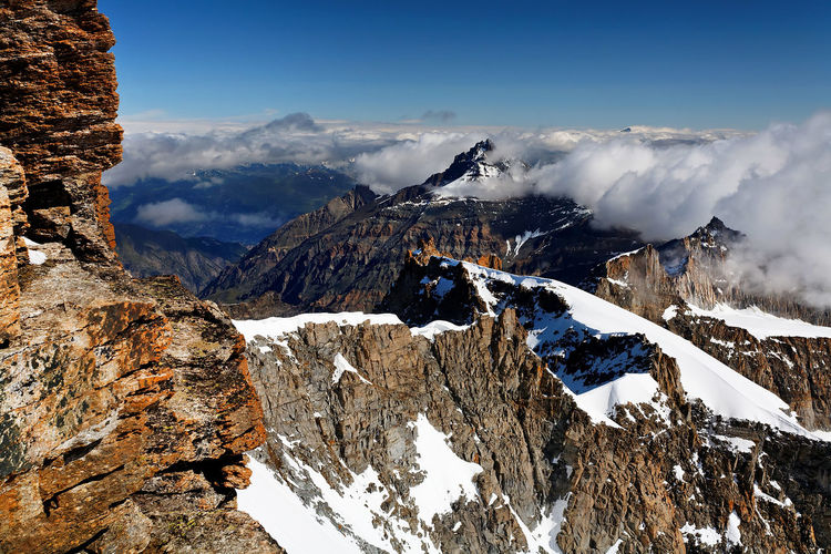 Scenic view of rocky mountains during winter at gran paradiso national park