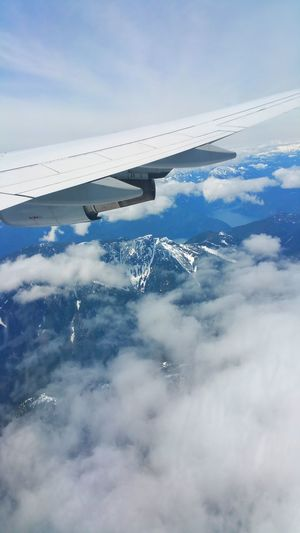 Sky high Canada Water Sea No People Cloud - Sky Nature Outdoors Day Blue Beauty In Nature Mountain Rock Peak Majestic Majestic Nature Experience Travel Journey Window Plane Window Sky View Cloud Flight Up High Blue Sky