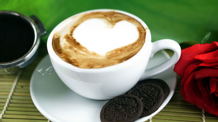 Love cappuccino coffee and chocolate cookies. A cup of latte, cappuccino or espresso coffee with milk put on a wood table with dark roasting coffee beans and roese. Aroma Bakery Beans Boiler Business Cafe Cappuccino Chocolate Christian Coffee Cookies Cream Drink Espresso Latte Latte Art Milk Morning Pressure Roasting Robust Stream Sweet Tables Wood