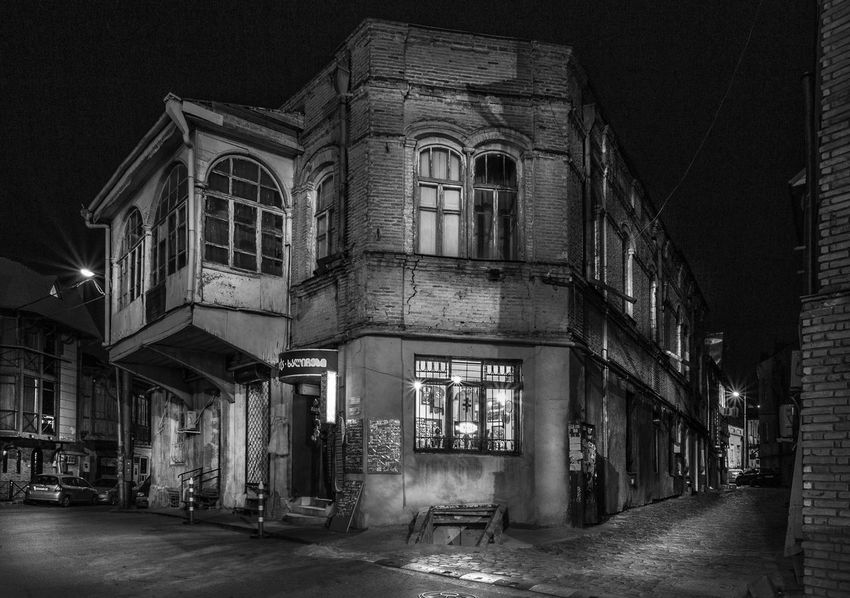 An old house of Tbilsi Black & White Travel Traveling Architecture Black And White Blackandwhite Blackandwhite Photography Building Exterior Built Structure City Illuminated Long Exposure Night No People Outdoor Photography Outdoors Sky Street Travel Destinations