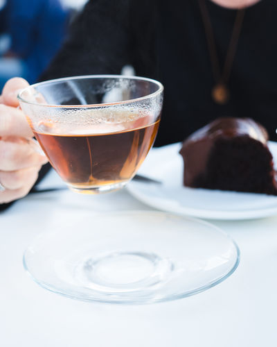 Drink Food And Drink Refreshment One Person Real People Hand Human Hand Lifestyles Human Body Part Cup Indoors  Table Glass Freshness Holding Leisure Activity Adult Focus On Foreground Drinking Glass Hot Drink Crockery Tea Cup Finger