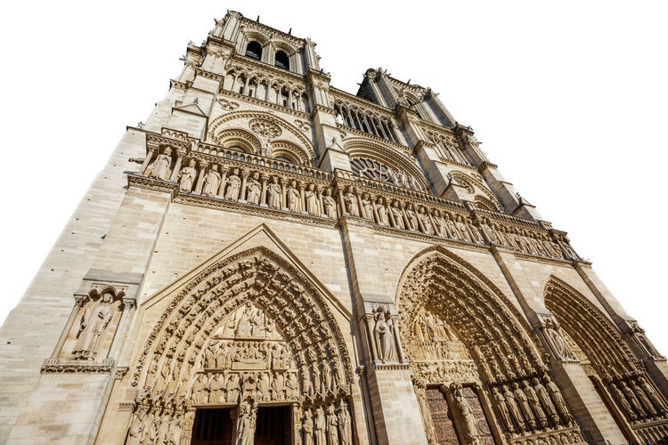 Notre Dame de Paris central main facade, national monument cathedral of France. French Gothic architecture. isolated on white background and copy space. Notre Dame De Paris Notre Dame De Paris Exterior Paris Church Cathedral France Isolated Isolated White Background Isolated On White Architecture Low Angle View Built Structure Building Exterior Sky Place Of Worship Belief Religion Spirituality Travel Destinations Arch Clear Sky Building History The Past No People Day Outdoors Gothic Style Ornate Ancient Civilization