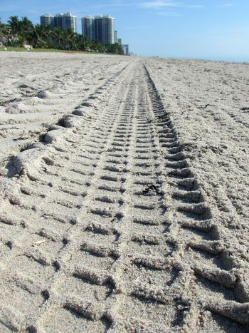 Tire Track Sand Beach Day No People Outdoors Architecture Nature Water's Edge Driving On The Beach Seashore Sandy Beach Lauderdale By The Sea Oceanfront Tire Tracks Horizon Leading Lines Pattern