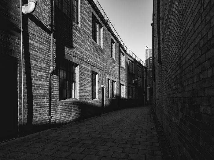 Moody Perspective Photography City Street Cumbria Micro Four Thirds Urban Geometry Architecture B&w Photography Blackandwhite Photography Brick Wall Buildings Day No People Shadows On The Wall