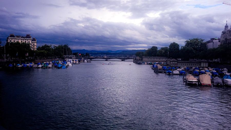 Zürichsee . Abend-DämmeRừng Cloud - Sky Sky Water Architecture Built Structure Building Exterior Outdoors Nature River Scenics Tree Beauty In Nature Day Vacations Large Group Of People People