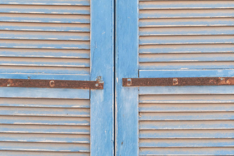Full Frame Closed Security Protection Safety Backgrounds Metal No People Pattern Entrance Day Door Wood - Material Close-up Shutter Blue Outdoors Architecture Rusty Iron Corrugated Garage Silver Colored Windowblinds Old
