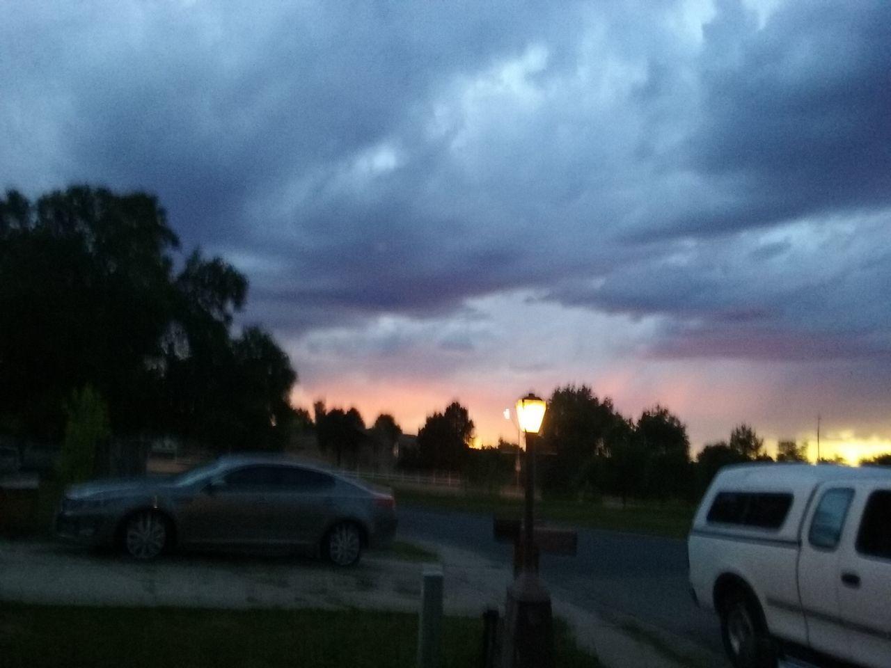car, sunset, land vehicle, sky, transportation, road, mode of transport, dusk, cloud - sky, sun, tree, nature, no people, outdoors, storm cloud, day