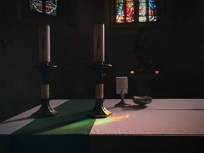 Altar in catholic church Stained Glass Vitrail Religious Icons Religion Candle Catholic Church Church Altar Table Indoors  No People Shadow Day