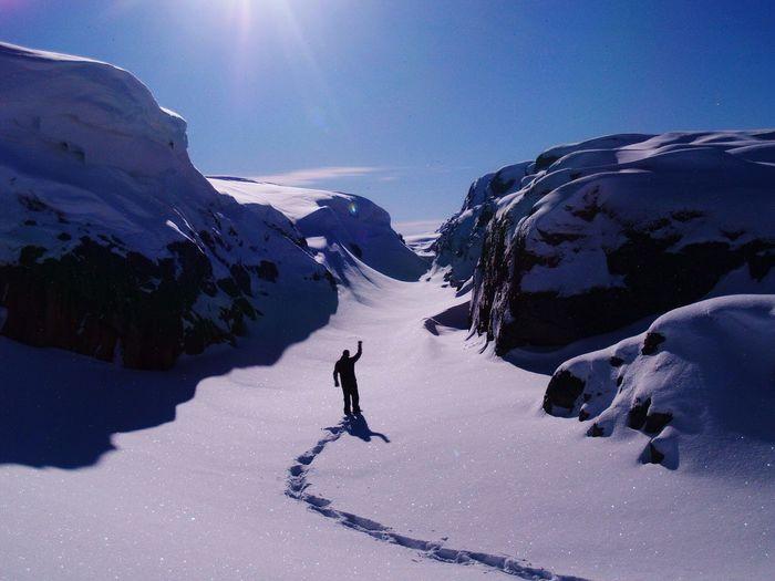 Tourist on snow covered mountain
