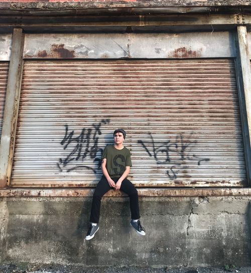 Graffitti Jughead Urban The CW Gritty Riverdale One Person Full Length Lifestyles Architecture Front View Built Structure Young Adult Real People Young Men Sitting Iron Day Casual Clothing Adult Leisure Activity Wall - Building Feature Building Exterior Portrait Outdoors